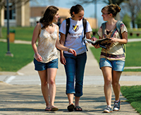 Photo of three students walking